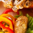 Fried chicken legs with vegetables — Stock Photo