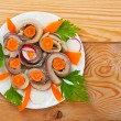 Salted fish (herring) rolls — Stock Photo #8023900