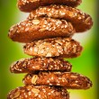 Oatmeal cookies with a splash of sunflower seeds, sesame seeds - Stock Photo
