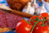 Sausage (salami), garlic, tomato branch, eggs — Stock Photo