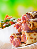 Meat rolls in the omelet, vegetable salad — Stock Photo