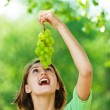Portrait of woman with bunch of green grapes — Stock Photo