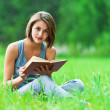 Girl - student reads book — Stock Photo