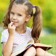 Royalty-Free Stock Photo: Portrait of young girl reading a book
