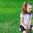 Girl (child) is riding on swing — Stock Photo #8099342