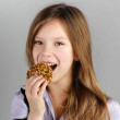Portrait of child (girl), bites oatmeal cookies — Stock Photo #8099398