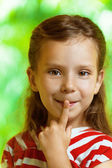 Portrait of girl shows sign of quiet — Stock Photo