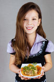 Girl (baby), holds plate with salad — Stock Photo
