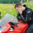 Portrait young man motorcyclist — Stock Photo