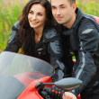 Royalty-Free Stock Photo: Portrait young gay couple man woman sitting motorcycle