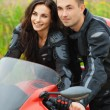 Portrait young gay couple man woman sitting motorcycle — Stock Photo