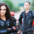 Portrait woman serious leather jacket gloves - Stock Photo
