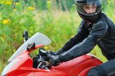 Portrait handsome man helmet sitting motorcycle — Stock Photo