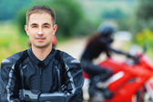 Young handsome guy motorcyclist — Stock Photo