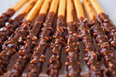 Crispy sweet straws filled chocolate — Stock Photo