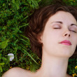 Woman sleeping on grass — Stock Photo #8473220