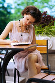Girl with pen outdoors — Stock Photo