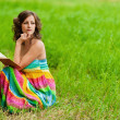 Portrait of beautiful woman holding book - Stock Photo