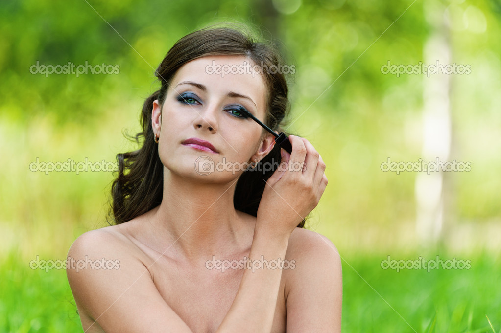 Portrait charming young woman bare shoulders looks mirror imposes shadow background nature — Stock Photo #8483768