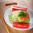 Crab sticks, cabbage, tomato, cucumber — Stock Photo #8498595