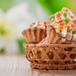 Few cakes in wicker basket — Stock Photo