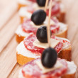 Royalty-Free Stock Photo: Sausage sandwiches, cheese and olives