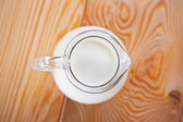 Milk in a jug on table — Stock Photo