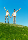 Young couple jumps — Stock Photo