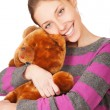 Stock Photo: Pretty young woman with teddy bear isolated on the white backgro