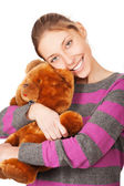 Pretty young woman with teddy bear isolated on the white backgro — Stockfoto