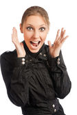 Woman crying out with lifted hands standing on white background — Stock Photo