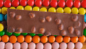 Colored, round chocolate candies in the frosting — Stock Photo