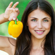 Smiling fair-haired woman holding Bulgarian pepper — Stock Photo