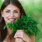 Portrait beautiful young woman green dill — Stock Photo