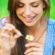 Woman wonders on flower - Stock Photo