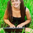 Gay pretty young woman glasses laptop — Stock Photo