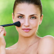 Girl with brush for makeup — Stock Photo