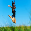 Woman jumps up — Stock Photo