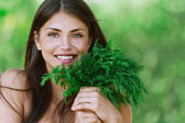 Portrait beautiful young woman green dill — Foto de Stock