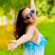 Young pretty smiling woman enjoying life — Stock Photo