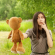 Young woman holding teddy bear — Stock Photo