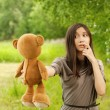 Young woman holding teddy bear — Stock Photo #8956821