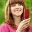 Royalty-Free Stock Photo: Portrait of young girl with mobile phone
