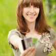 Young woman holding several credit cards — Stock Photo #8957312