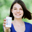 Young brunette woman with mobile phone — Stock Photo