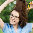 Young woman cutting her hair — Stock Photo