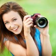 Young smiling woman with camera — Stock Photo #9214642