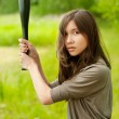 Young asian woman with bat — Stock Photo #9229288