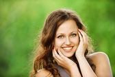 Portrait of beautiful young smiling woman — Stock Photo