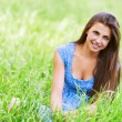 Charming young woman sitting green grass — Stock Photo